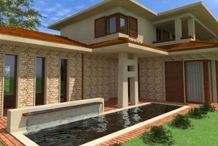 Construção de moradia com espelho d'água e fachada revestida a pedra.