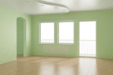 Pintura em sala com paredes verdes.